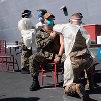 Vaccinations were given pierside to the USS San Diego's crew and embarked Marines in March.