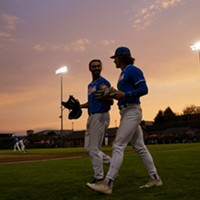 Outfielders Tyler Ganus (Left) and Josh Lauck (Right) head out to take the field as the sun begins to set over Arcata Ballpark on July 27, 2021.