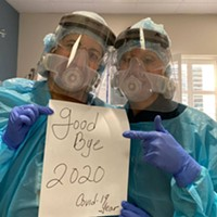 Two intensive care unit nurses Gabby Caster and Julie Bruce celebrate the end of 2020.