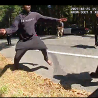 The video shows Robert Anderson picking up the knife and lunging with it at officers before running down the street toward a woman at the scene, at which point officers fatally shot him.