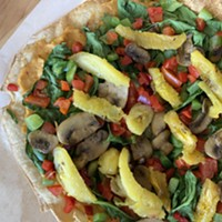 The veggie flatbread, essentially a salad that knows how to have a good time.