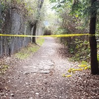 Police tape blocks off an area in Blue Lake where a dead body was found Sunday.