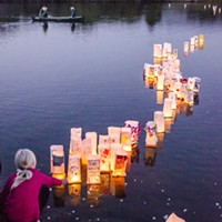 Lanterns float out onto Klopp Lake during the 33rd annual ceremony.
