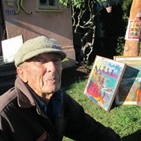 Otto in his yard among his paintings last winter.