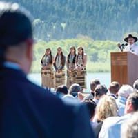 From left to right: Erica Young, Aleaha Aguilar, Chu-cheesh O'Rourke and Faith Kibby stand sentry as Yurok Tribal Chair Thomas O'Rourke speaks at a signing celebration last month for a new agreement to remove four dams from the lower Klamath River. Photo by Mark McKenna