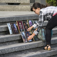 "Tamara McFarland, of Bayside, one of the informal organizers of the ""Solidarity Vigil for Our Beloved Community,"" arrived early to place 11 framed portraits of recently killed black persons and the Dallas law enforcement officers on the county courthouse steps in Eureka."