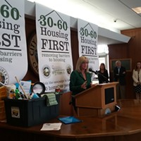 "Supervisor Virginia Bass speaks at the launch of the city and county's Housing First campaign. The cleaning supplies were donated by a local outreach group as a ""welcome home"" gift to new renters."