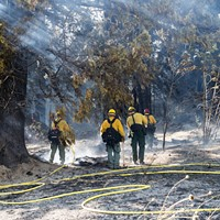 Crews from Cal Fire fight a blaze just north of Stafford on Thursday.