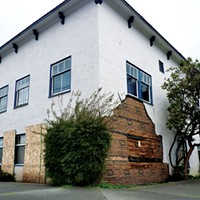 Improvements have been made to the 833 H St. apartment complex owned by Floyd Squires, pictured here after earthquake damage in early 2010, but broken windows and other repairs remain to be done at the building that was the subject of a succesful nuissance lawsuit brought by neighbors.