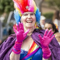 Parade marshal Linda Shapeero brought the color with her Pride ensemble and signature rainbow earrings.