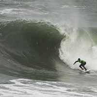 Organizer Chris Johnson catching a wave.