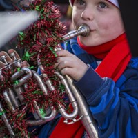 Jude Carter, 6, of Eureka, played in his fourth TubaChristmas performance, along with his father and grandmother, in front of a crowd of 100 or more at the Gazebo in Old Town Eureka on Saturday, Dec. 3