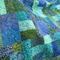 """""""Splash,"""" the queen-sized Opportunity Quilt to be raffled off at the Heart of the Redwoods Quilt Show."""