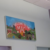 A sign welcoming visitors to the MAC.
