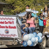 Participants representing the Yurok Tribe Social Services Department advocated for salmon and dam removal and tossed candy to the crowd from their parade float at the 2016 Klamath Salmon Festival.