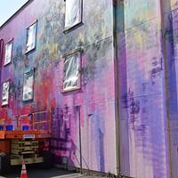 Muralist Duncan Jago and Joe Murdter work on the De Paul Building.