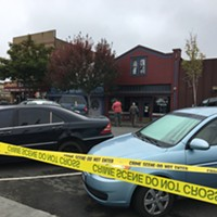 The taped-off crime scene at bar row on the Arcata Plaza.
