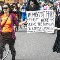 Protesters carried signs in the 2016 Humboldt Pride march.