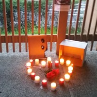 Candles lit in honor of David Josiah Lawson