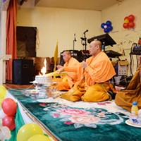 Monks from Wat Lao Saysettha, a Buddhist temple in Santa Rosa, deliver the New Year blessings and prayers.