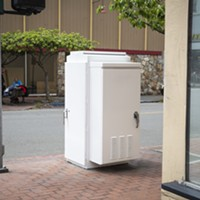 "The now white utility box near the corner of Fifth and G streets that once showcased ""Cat Food."""