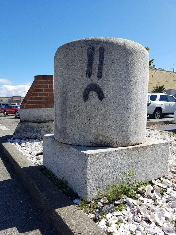 Frowny graffiti on Fourth Street in Eureka. - PHOTO BY GABRIELLE GOPINATH.