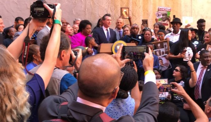 Gov. Gavin Newsom, crowd at signing ceremony for use-of-force bill. - PHOTO BY DAN MORAIN, CALMATTERS