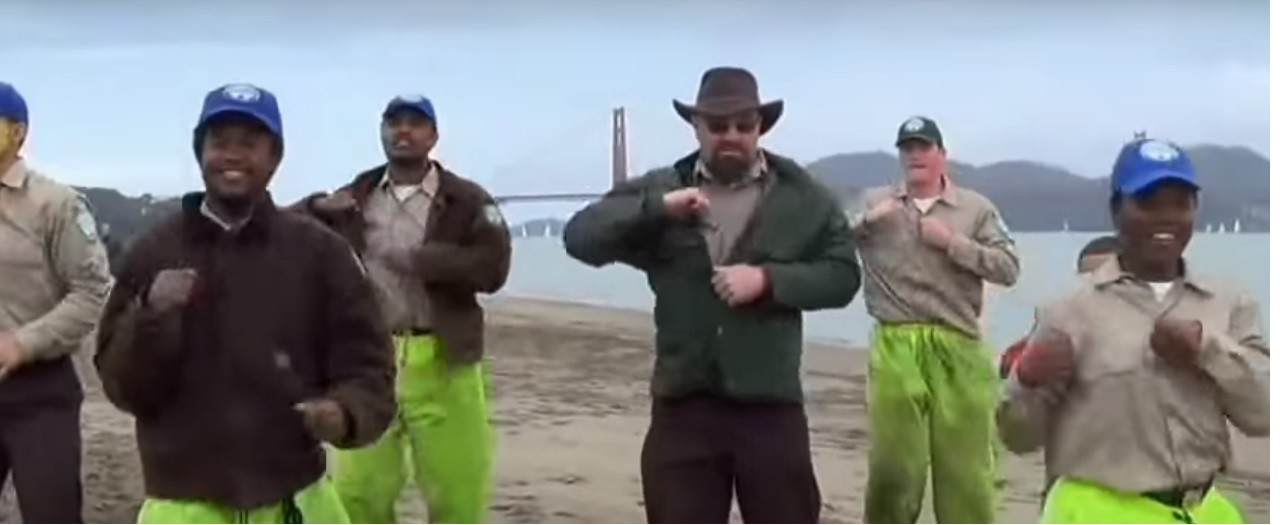 Griffith (in sunglasses) and CCC corpsmembers performing at Golden Gate National Recreation Area in 2014. - YOUTUBE