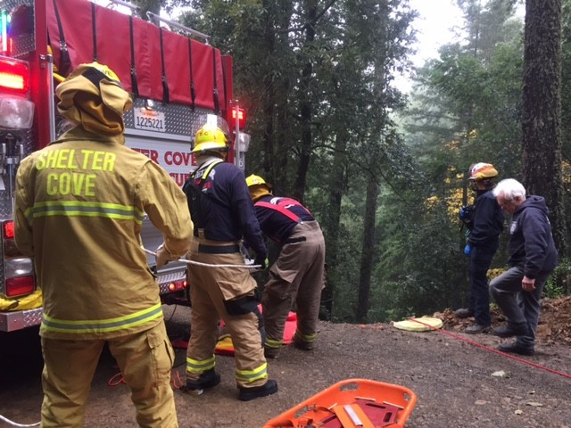Volunteer firefighters at the scene of this morning's crash on Chemise Mountain Road off Shelter Cove Road. - COURTESY OF SHELTER COVE FIRE DEPARTMENT