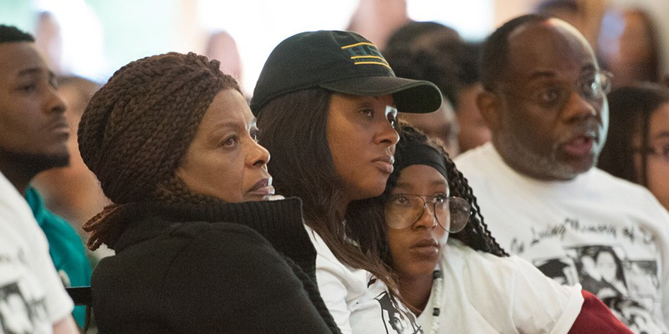 Josiah Lawson's mother, Charmaine, and grandmother listen to a speaker at her son's 2017 memorial service. - FILE PHOTO