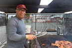 Sammy's dad at the grill.