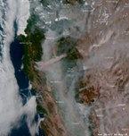 Satellite imagine of wildfire smoke.