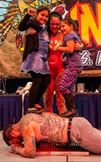 During the afternoon Captain's Side Show, two girls were recruited from the audience to add some weight to performer Dustin Mathis (of SB Body Arts in Oklahoma City) as he rested on a bed of nails.