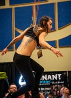 Monica Ortiz, of Red Bluff, was next up to be launched into the air by Dustin Mathis (of SB Body Arts in Oklahoma City) using hooks through the skin of her back in the afternoon Human Suspension performance.