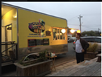The Simmer Down Caribbean Cafe truck parked by the Arcata Playhouse for an event.