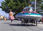 A flying saucer festooned with rhododendrons for the parade.
