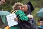 HSU President Lisa Rossbacher and Charmaine Lawson embrace after Lawson accepted an honorary degree on behalf of her son, David Josiah Lawson.