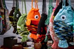 This is not a yarn bombing but an appropriate yarn craft design for a Fish Festival at this vendor.