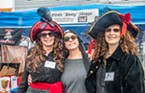"Donated jewelry and other ""booty"" was up for sale at the Trinidad Civic Club's booth as a fundraiser to repair and maintain the old Trinidad lighthouse. Katherine Wayne (left), Gale Becker and Jan West, co-president of the Club, dressed up like pirates to help capture the attention of attendees."