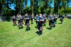 Members of the Humboldt Highlanders Pipe Band and The Jefferson Pipe Band in formation.