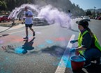 Runners in the Ney-Puey Color Run on Saturday morning endured multiple handfuls of colored powder during the race..