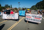 The parade also featured signs advocating tribal water rights, dam removal and environmental protection.