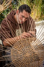 Jared Lincoln, of Klamath, was part of the group doing Native American basket-weaving demonstrations.