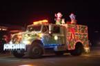 An emergency vehicle done up like a shiny present.