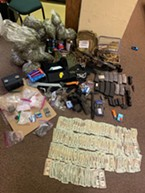 Drug, guns and money found in the vehicle.