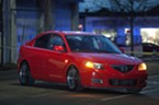 The red Mazda allegedly stolen from Sole Savers and abandoned about a block away.