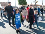 Pastors Bethany and Jason Cseh and their children held signs of love over hate as they marched down C Street in Eureka.