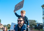 Pastor Jason Cseh carried his son on his shoulders during the march.