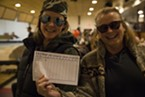 Karen Smith and her daughter holding up their score card from the the LeBOWLski event at the E&O bowling alley.