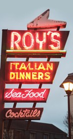 The neon sign at Roy's, now dark.